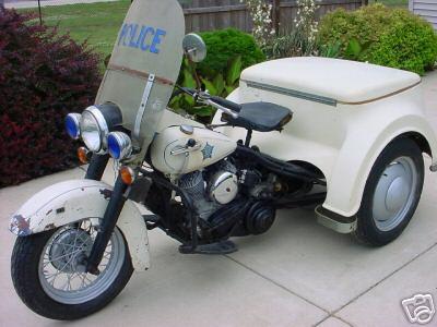 http://www.motorbike-search-engine.co.uk/classic_bikes/harley_davidson_servi_car.jpg